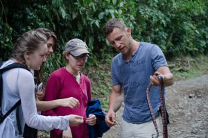 Minnema teaches students and other interns about a milk snake.