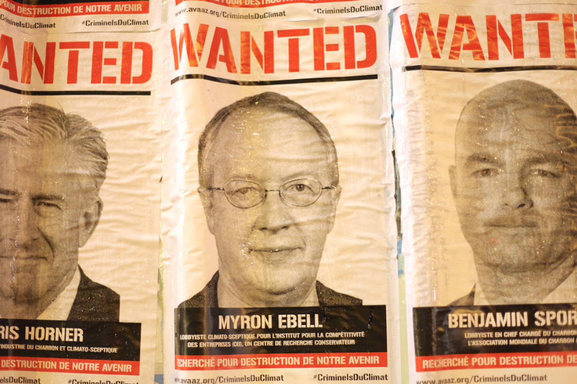 Signs of Myron Ebell and fellow climate change deniers posted in Paris during discussions on the Paris Agreement