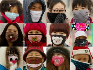 A combo photos show tourists wearing mask at Tiananmen Square in Beijing's continuous smog day. 30JAN13 == Photo by Simon Song ==